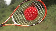 Tennis Racket vs Water Balloons at 25,000 fps Slow Motion
