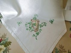 Irish Linen tablecloth with shamrocks and harp embroidery.