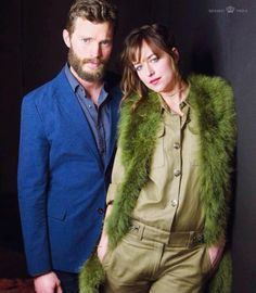 Jamie Dornan and Dakota Johnson looking absolutely stunning!! Love the colorful outfits. Brings out both their eyes!! 50 Shades of Christian and Ana