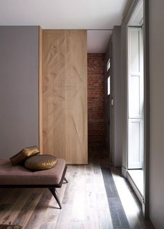 3d CNC milled sliding door in a Chelsea townhouse designed by Archi-Tectonics