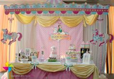 A Carousel themed birthday party! Design and setup of backdrop, venue decor and candy buffet by ParteeBoo - The Party Designers!