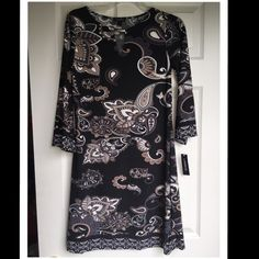LAVANYA BLACK PRINT TUNIC DRESS SIZE Small This Tunic dress is mid length with a paisley formal print and keyhole neck line.  It's 92% polyester & 8% spandex. Size Small. NO TRADES! I accept reasonable offers! Tavanya Dresses Midi
