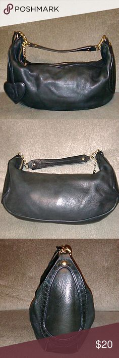 Leather Juicy Couture Handbag This is a nice bag. Has a little scratching on one side. A little black polish will take care of that. Cute little bag! Juicy Couture Bags