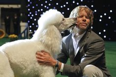 "Out of the Past (Part 1) NCIS LA Pictured: Eric Christian Olsen (LAPD Liaison Marty Deeks) with ""Chaucer"" (Ramen, left)."