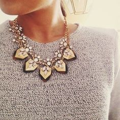 Statement necklace on grey sweater
