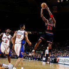 Michael Jordan. Shooting over Allan Houston and the Knicks.