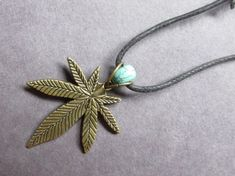Hey, I found this really awesome Etsy listing at https://www.etsy.com/listing/189446162/bronze-pot-leaf-necklace-turquoise-bead