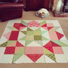 "Gigantic Scrappy Christmas Swoon quilt! Will be 60"" finished and made *nearly* all from stash and scraps - I only had to buy a few pieces of the background fabrics and one of the reds! I'm normally a bit of a Christmas grouch (too stressy!) but this quilt actually has me looking forward to it!"