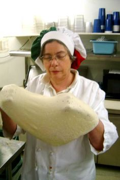 Jan's Village Pizza, Westfield, Indiana (317) 896-5050 Jan stretching our home made dough
