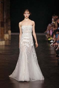 Beautiful details on this white Basil Soda gown