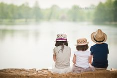 3 children sitting by lake, via Flickr.