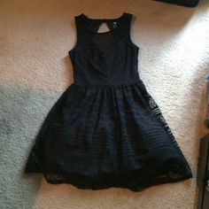 Macy's black dress Black gorgeous dress from Macy's. Worn once. In great condition. Length is 33 in. Pretty lace design on first layer of dress, with a black liner with tutu and bottom for extra puff. Want more pictures let me know Trixxi Dresses Midi