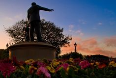 Walt and Mickey have the perfect view for the sunrise over Disneyland!