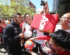 Manchester United's Memphis Depay  signs autographs for fans after a training session as part of the team's pre-season tour