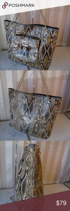 """Gorgeous Love Moschino Snake print leather tote CLEARANCE SALE...NO OFFERS PLS...Size 15.5/11.5/5.5/ 20"""" drop"""" . Presenting another lovely Love Moschino Tote shoulder bag in snake print faux leather with gold tone hardware and gold shoulder strap. Imported, Pre loved, light wear, in excellent-pristine like new condition. This bag features easy access to all your stuff, high quality material, Solid construction, and skilled workmanship....returns accepted, no questions asked.. Love Moschino…"""