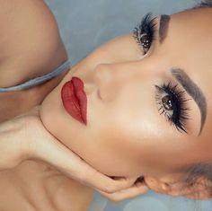 Dramatic eye makeup and red lipstick.
