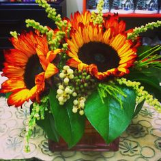 Sunset.  This stunning arrangement of tinted sunflowers created by Regan Beaudry.
