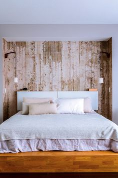 LAXseries Platform Bed and Storage Headboard | Bedroom Detail by Lori Andrews Interiors. Wallpaper from the Modern Shop, Hanging sconces from Cedar & Moss