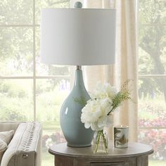 This beautiful table lamp is constructed of ceramic. It's the perfect way to add a pop of color to any design.