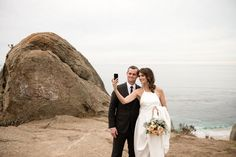 bride and groom taking selfie after their ceremony.