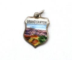 Grand Canyon Enamel Travel Shield Sterling Silver Bracelet Charm Arizona by SterlingRevival on Etsy