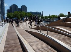 I could check this out when in Toronto Project: Waterfront Toronto  Designer: West 8  Location: Toronto, Canada    The Simcoe WaveDeck, one of four uniquely Canadian wavedecks planned for the Waterfront Toronto, is as artistic as it is functional. Located at the water's edge, the wooden wavedeck features an informal public amphitheatre-style space with impressive curves that soar as high as 2.6 metres above the lake.    http://www.west8.com/projects/all/simcoe_wavedeck/
