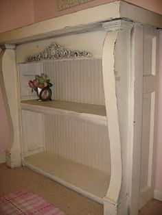 old fireplace mantle turned into bookcase - very clever by mai