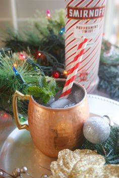 If you are looking for some delicious drinks with peppermint vodka this holiday season, you'll love these Candy Cane Christmas Mules made with SMIRNOFF Peppermint Twist Vodka. Christmas Recipes | Vodka Recipes | Moscow Mules #christmascocktails #peppermintvodka
