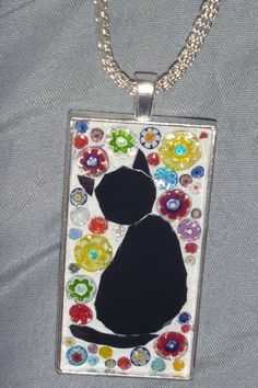 Left facing Black cat mosaic pendant  with millifiori background and flat chain