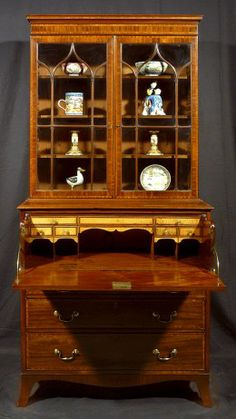 A George III Mahogany and Satinwood Secretaire-Bookcase of Elegant Proportions - Hyde Park Antiques, Ltd.