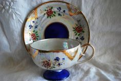 Hey, I found this really awesome Etsy listing at https://www.etsy.com/listing/223159718/vintage-tea-cup-blue-cobalt-and-gold-tea