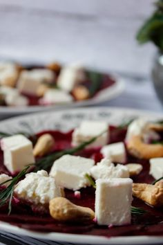 Beetroot carpaccio with soft feta cheese and cashew nuts. Served drizzled with lemon juice, agave and olive oil syrup. Light and tasty.