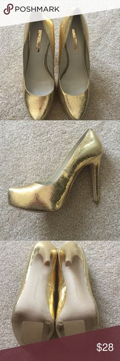 BCBGeneration Sz 8 Gold pumps pre owned Gold Pebbled leather SZ8 BCBGeneration pumps . 2 1/2 inch heel worn twice great condition . No original box . Price when purchased was over $ 100.00 BCBGeneration Shoes Heels