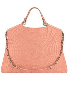 Chanel bag in coral. Normally not a fan of their bags, but this is stunning.