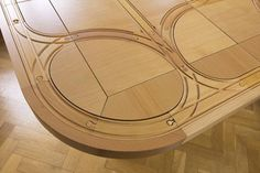 This table has special places for wooden train tracks set into it! Amazing!