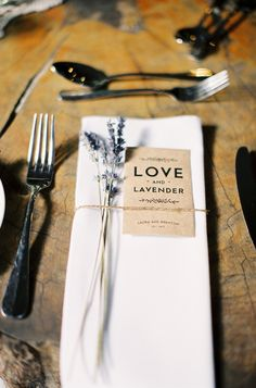 http://www.elblogdeboda.com/ lavender seed favors + sprigs of lavender tied around napkin. pretty!