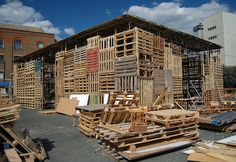 Jellyfish Theatre is a temporary improvisation being constructed in London with available recycled materials including pallets, plywood, water bottles and old theater sets being by architects/artists Kaltwasser and Kobberling and 81 volunteers including unemployed architects and carpenters. The 120 seat theatre will be open from 26 August to 9 October after which it dismantled and its recycled materials recycled again.