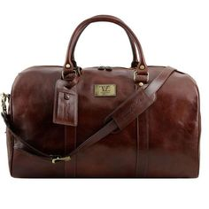 Brown Travel Leather Duffle Bag TL141247-Brown is a convenient to use bag, especially for short trips and travels.