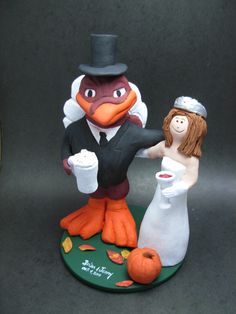 Custom made to order college mascot wedding cake toppers, individually hand sculpted of kiln fired clay. Incorporate your team jersey, sport, favourite items, whatever is important to the bride and groom. $235  www.magicmud.com 1 800 231 9814 magicmud@magicmud... blog.magicmud.com twitter.com/... $235 #mascot #collegemascot #hokie #ms.wuf #gators #virginiatech #football mascot #wedding #cake #toppers #custom #personalized #Groom #bride #anniversary #birthday #weddingcaketoppers #caketoppers #figurine #gift nhttps://www.facebook.com/PersonalizedWeddingCakeToppersnhttps://www.tumblr.com/blog/custom-wedding-cake-toppersnhttp://instagram.com/weddingcaketoppers/n
