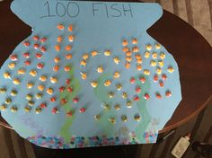 100 day My 4 yr old cut out the tmo, we drew and colored seaweed and rocks then glued in 100 gold fish in 10's of one colour