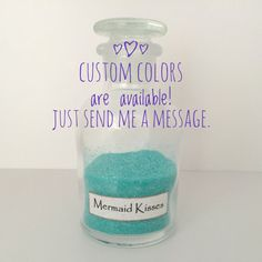 *** In stock and ready to ship *** This Mermaid Kisses bottle will be the perfect finishing touch for the mermaid in your life! Each glass bottle was filled halfway with turquoise glitter. The label is white with black letters and has been gently aged. Custom glitter colors are
