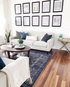 Decorating with blue in the living room-blue vintage distressed rug-blue velvet pillows-white walls-#gallerywall #livingroomdecor