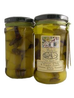 Cheese olive tomato salad - Prepared according to Lesvos Island cheese making traditions, then aged for 3-4 months in containers of olive oil. When matured it is cut and put into jars with the remaining ingredients. An ideal accompaniment to wine and aperitifs.