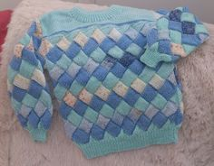 Mint and multi colour from deep blue to flecked cream / lemon combine in this 22 inch / 56 cm chest jumper. Machine washable acrylic, this costs £12.00 + p&p £4.35. Message me for further information or to order