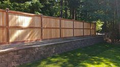 AJB Services replaced a chain link fence with a retaining wall and privacy fence to insulate against road noise on this Lacey property. Wooden Retaining Wall, Building A Retaining Wall, Concrete Retaining Walls, Flagstone Pavers, Concrete Fence, Privacy Landscaping, Backyard Privacy, Backyard Ideas, Privacy Fences
