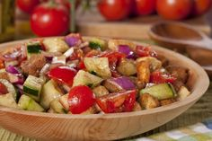 Fresh tomatoes, cucumbers, and onions make this the perfect summer salad. The homemade dressing on top makes it even more irresistible!