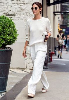 Lily Aldridge in her J BRAND Reese Sweater in Linen.