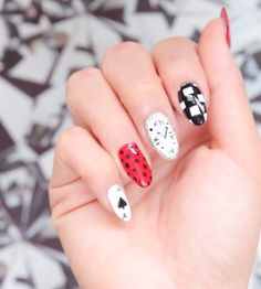 This Alice in Wonderland nail art is whimsical and wonderful | [ https://style.disney.com/beauty/2016/05/19/this-alice-in-wonderland-nail-art-is-whimsical-and-wonderful/ ]