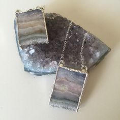 """Words like """"ethereal"""" and """"magical"""" come to mind when thinking of these stunning agate column pendants. The colors and banding of each piece looks like it could have been hand painted with water colors. These pendants have a super sparkly druzy edge on the bottom. Hangs from a delicate 20"""" sterling silver chain."""