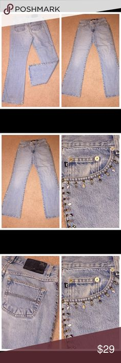 Express cotton jeans lt blue w/ Bling studs Sz 7/8 073017-24 Express ladies cotton jeans, lt blue with decorative studs, Sz 7/8 Express ladies 100% cotton denim jeans in lt blue with silver/gold/colored studs down side of slightly flared jeans, Sz 7/8 (Note: they come up to waist; not hip-hugger) Waist - 30 Inseam - 29 Express Jeans